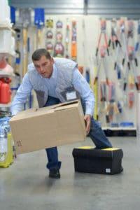 man-stumbling-while-carrying-box
